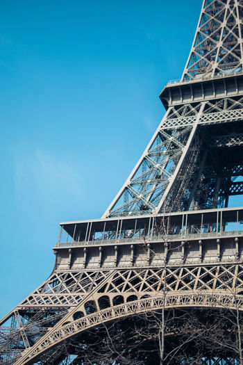 Low angle view of eiffel tower against clear blue sky
