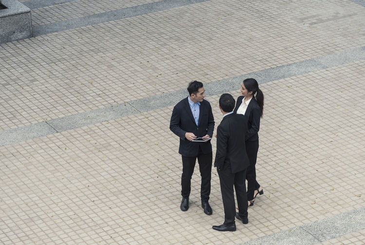 High angle view of business people standing on street