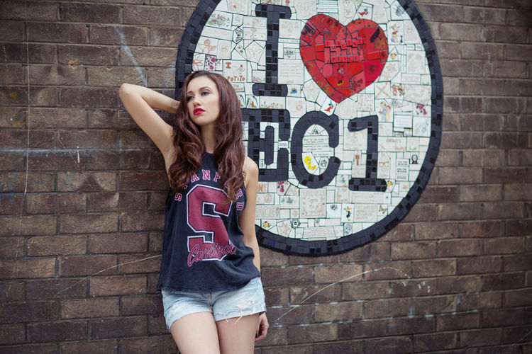 Brick Wall Casual Clothing Day Front View Leisure Activity Lifestyles Outdoors Portrait Red Standing Wall - Building Feature