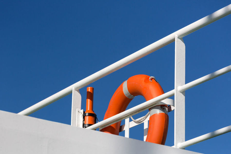 Against The Sky Balustrade Blue Blue And White Blue Sky Bright Clear Sky Colour Of Life Ferry Handrail  High Section Leading Lines Life Buoy Lifesaver Low Angle View Minimalism Orange Color Outdoors Part Of Pivotal Ideas Safety Simplicity Sky Vivid Colours  White