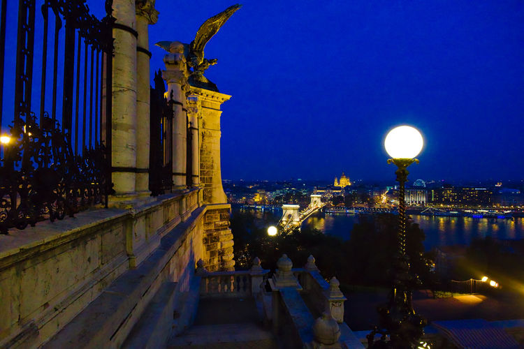 Illuminated city and danube river against sky seen from buda castle