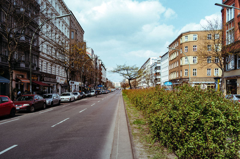 Morning mood with blue sky Architecture Berliner Ansichten Building Built Structure City City Life City Street Cloud Cloud - Sky Day Diminishing Perspective Kreuzberg No People Parking Residential Building Residential District Residential Structure Road Showcase April Sky Street The Way Forward Urban Urban Spring Fever Vanishing Point