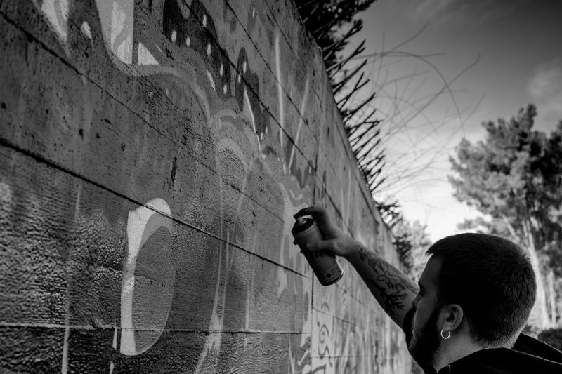 Spruzzi Spray Liberty Love Vandalism Vandal Blackandwhite Graffiti Art Street Art Writing On The Walls Writing One Person Real People Childhood Day Outdoors Leisure Activity Lifestyles People Human Hand Architecture