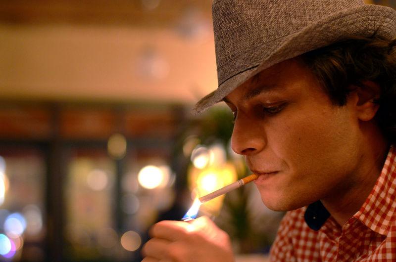 Bokeh Photography Casual Clothing Cigarettes Close-up Cowboy Hat Davidshubladze Handsome Man Headshot Portrait Portraitoftheday Real People Smoking Tamar Mirianashvili Young Adult