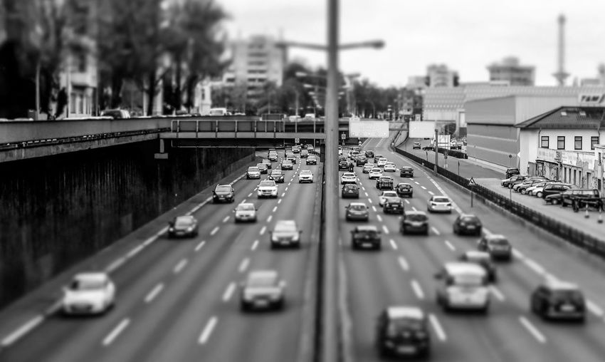 Tilt-Shift Image Of Cars On Bridge