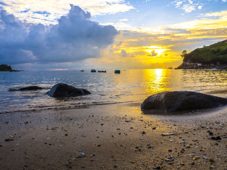 Sunrise with cloudy sky at Jemur Island Indonesia INDONESIA Pulau Jemur Bagansiapiapi Beach Beauty In Nature Cloud - Sky Horizon Over Water Land Nature No People Non-urban Scene Outdoors Riau Rock Rock - Object Sand Scenics - Nature Sea Sky Solid Sunrise Sunrise And Clouds Tranquil Scene Tranquility Water