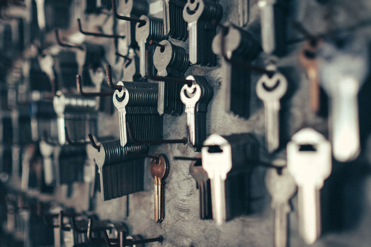Security DIY Hardware Store Keys Locks Close-up Hanging In A Row Indoors  Locksmith Metal Padlock Selective Focus Still Life Variation