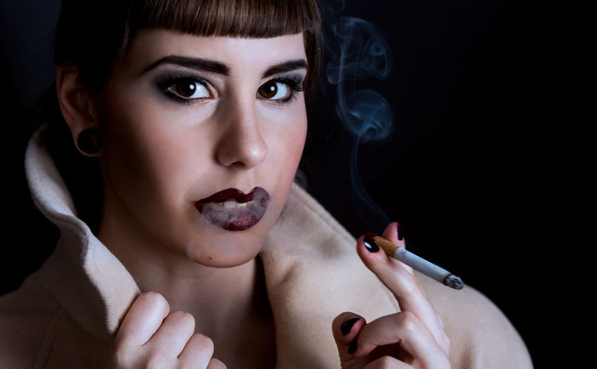 Smoking, young lady, cigarette, coat, darkness, mysteriuos Lifestyles Beauty Black Background Studio Shot The Portraitist - 2018 EyeEm Awards