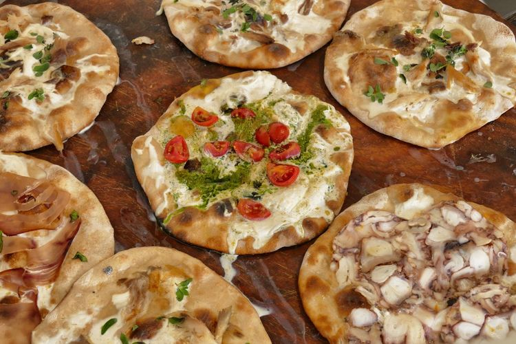 Appetizer Baked Bread Cheese Close-up Dairy Product Flatbread  Food Food And Drink Freshness Garnish Herb High Angle View Indoors  Italian Food No People Pizza Ready-to-eat Snack Still Life Unhealthy Eating Vegetable