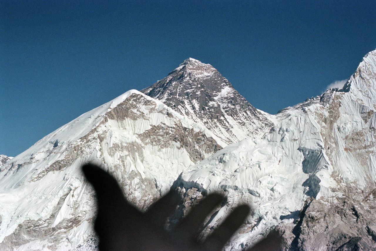 Scenic View Of Snow Mountains Against Clear Blue Sky