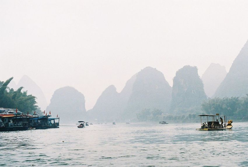 Analogue Photography EyeEmNewHere Film Minolta Beauty In Nature China Copy Space Day Film Photography Filmisnotdead Fog Mountain Mountain Range Nature Nautical Vessel No People Outdoors River Sailing Scenics Sky Tranquility Water Waterfront Yangshuo