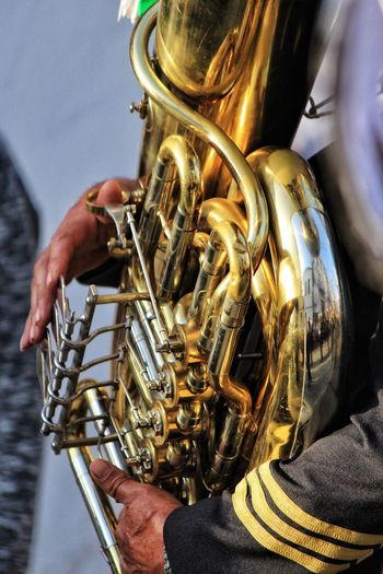 Close up of a musician playing the tuba during an Easter parade in San Roque, Spain Brass Band Brass Colour Brass Instrument  Playing An Instrument Tuba Close Up Tuba Player Tuba Playing Arts Culture And Entertainment Close-up Gold Colored Holding Human Body Part Human Hand Human Hands Metal Music Musical Equipment Musical Instrument Musical Instruments Musician Playing Trumpet Tuba Wind Instrument Wind Instruments
