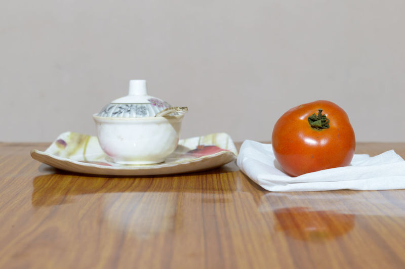 Fruits and tea on table