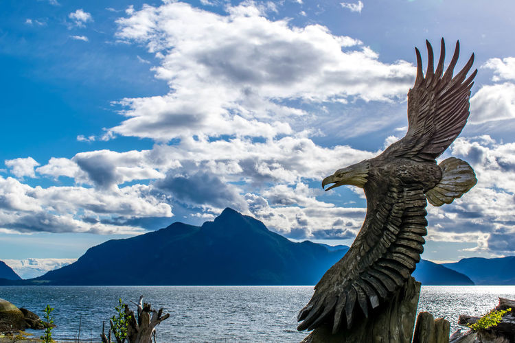 Amazing Beauty In Nature Cloud - Sky Day Eagle Mountain Mountain Range Nature No People Outdoors Scenics Sculpture Sculptures Sky Statue Talent Tranquil Scene Tranquility Water