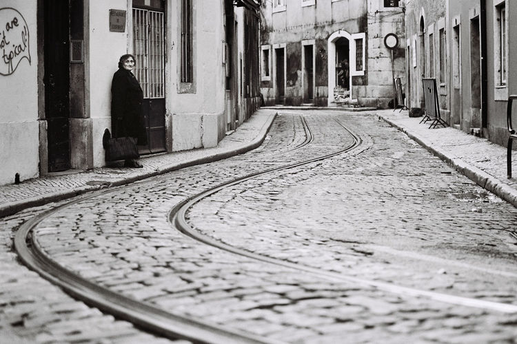 I took this picture of a woman waiting for the tram in the streets of Lisbon, Portugal. Lisbon Rail Transportation Railroad Track Street Photography The Street Photographer - 2017 EyeEm Awards Tramlines