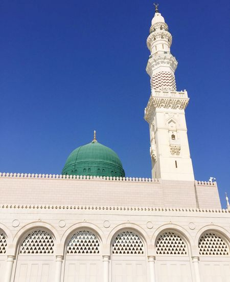 Low angle view of al-masjid an-nabawi against blue sky