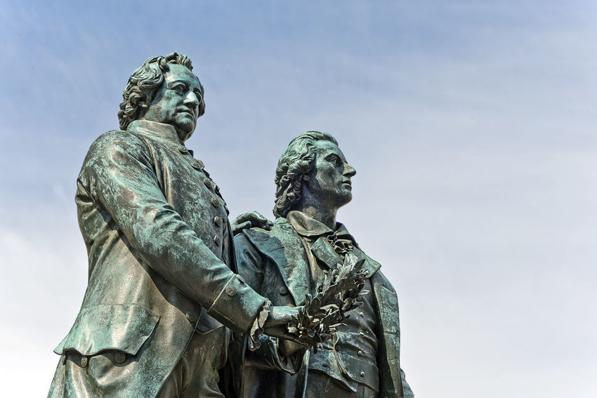 Goethe and Schiller Statue in Weimar, Germany Schiller Architecture Art And Craft Blue Craft Creativity Day Friedrich Schiller Goethe History Human Representation Low Angle View Male Likeness Memorial Monument Nature No People Outdoors Representation Sculpture Sky Statue The Past