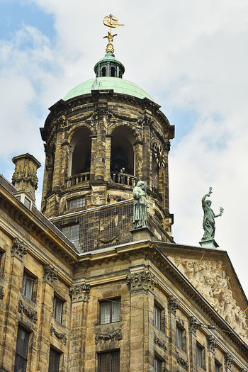 Amsterdamcity Architecture Building Exterior Built Structure Cloud - Sky Damm Day History Low Angle View No People Outdoors Royal Palace Amsterdam Sculpture Sky Statue Travel Destinations