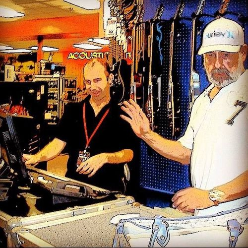 ORLANDO FLORIDA USA Guitar Center Guitar Store Adult Day Guitar Guitars Indoors  Men Occupation Only Men People Real People Senior Adult Senior Men Small Business Two People Working Workshop