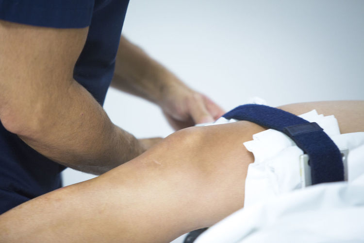 Midsection of doctor examining patient in hospital
