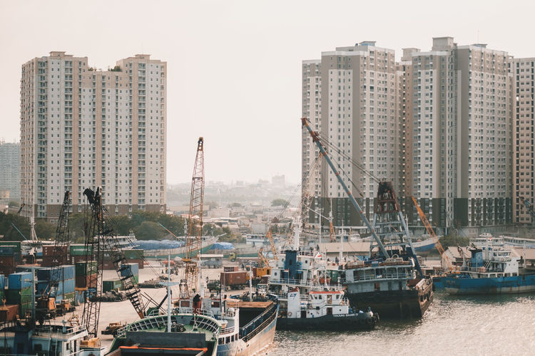 Nautical Vessel Water Building Exterior Architecture Mode Of Transportation Transportation City Built Structure Harbor Sky Building Waterfront Crane - Construction Machinery Nature Day Machinery Ship Sea Clear Sky No People Office Building Exterior Cityscape Sailboat Skyscraper Tall - High