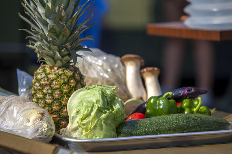 Close-Up Of Various Vegetables And Fruits In Tray On Table