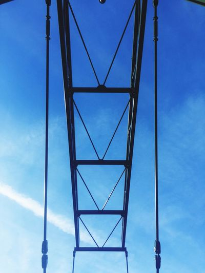 Architecture Hanging Bridge Symmetry Symmetrical Symbol Low Angle View Sky Blue Cloud - Sky Day Outdoors No People Nature