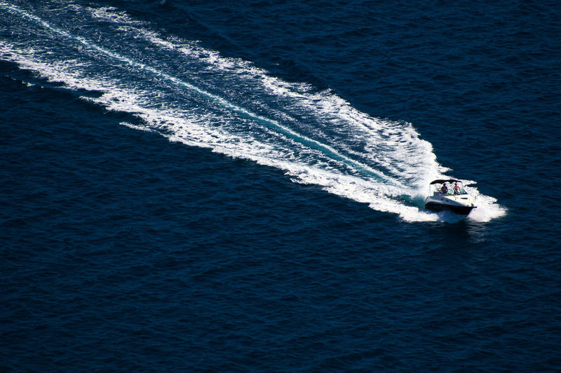 High angle view of jet boat sailing on sea
