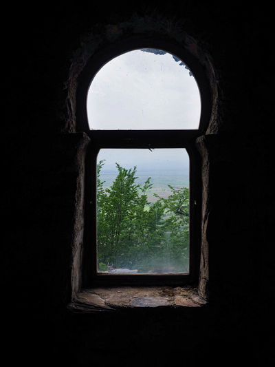 Close-up of window in old abandoned building