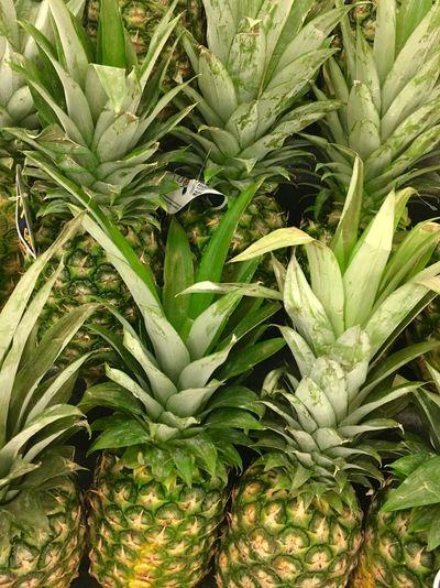 Full frame shot of pineapples at market