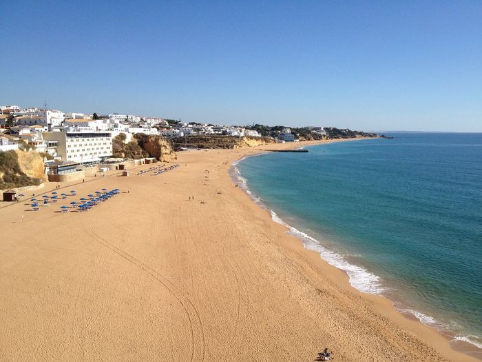 Albufeira in November Algarve Autumn Autumn Sun November Portugal Quiet Winter Beach Apartment Beach Beach Lounger Beauty In Nature Clear Sky Day Horizon Over Water Hotel Nature Outdoors Sand Scenics Sea Sky Tourism Tranquility Water Winter Getaway