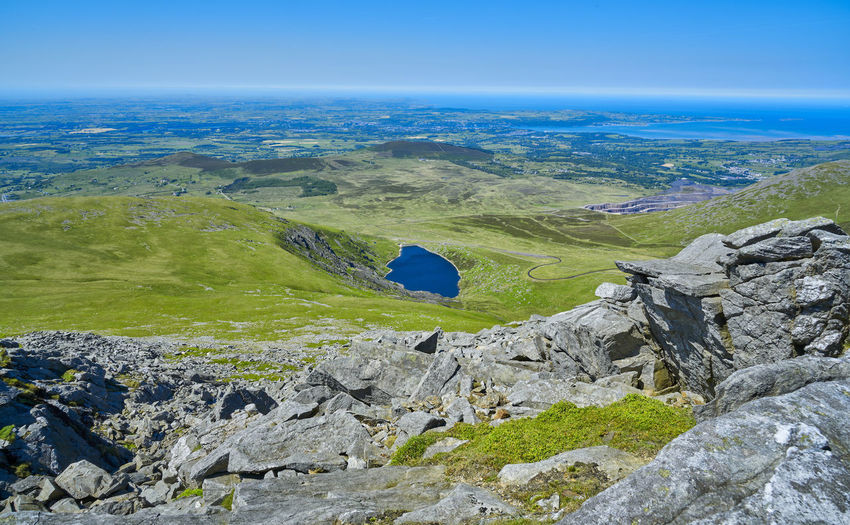 Views from the summit of the Snowdonia mountain range in North Wales, UK, Aerial View Beauty In Nature Blue Blue Sky Cliff Day Grass Landscape Landscapes Mountain Mountain Range National Park Nature No People Outdoors Rock - Object Scenics Sky Snowdonia Summit Trekking Wales Wales UK Wales❤
