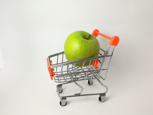 green apple in the trolley Green Apple Apple - Fruit Fruit Healthy Eating Consumerism Studio Shot Basket Granny Smith Apple Shopping Cart Healthy Lifestyle Food And Drink Food Supermarket White Background Shopping Basket Groceries Indoors  Freshness Close-up Food Stories