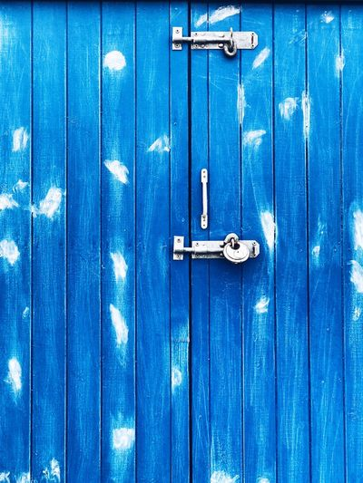 Full frame shot of closed blue wooden door