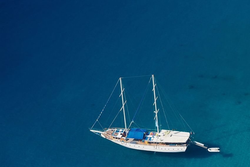 Paragliding over blue sea and sailing boats Nautical Vessel Mode Of Transport Transportation Copy Space Water Blue Nature No People Day Outdoors Sea Moored Mast Clear Sky Sailing Beauty In Nature Sky Paragliding Aerial View Ölüdeniz, Fethiye Blue Lagoon Turkey