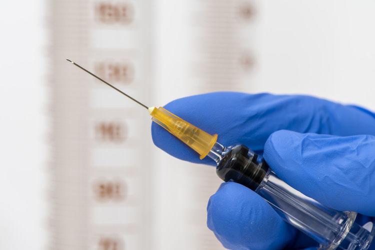 Close-up of healthcare worker holding syringe