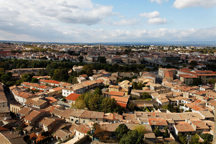 Aerial view of the base city of Carcassonne in Aude department of France Aerial Shot Architecture Carcassonne Cityscape Houses Travel Aerial View Base City Buildings Cityscapes District Homes Horizon Horizon Over Land Landmark Medieval Town Roofs Tourism Travel Destinations Urban