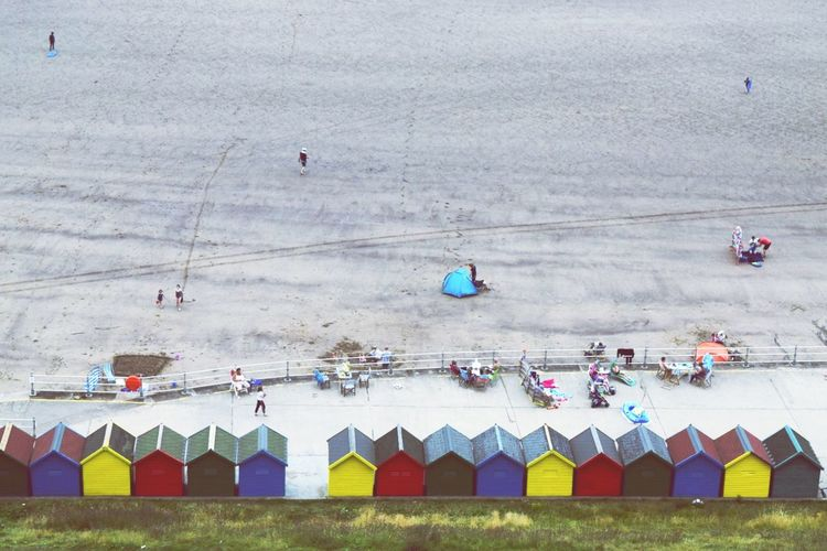 High Angle View Of People Enjoying On Beach At Whitby