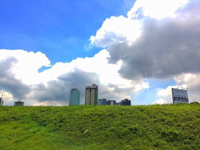 Cloud - Sky Sky Green Color Field Growth Outdoors Urban Skyline Day Eyeem Philippines Lgv20photography Lgv20 Green Grass Blue Sky Beauty In Nature Architecture