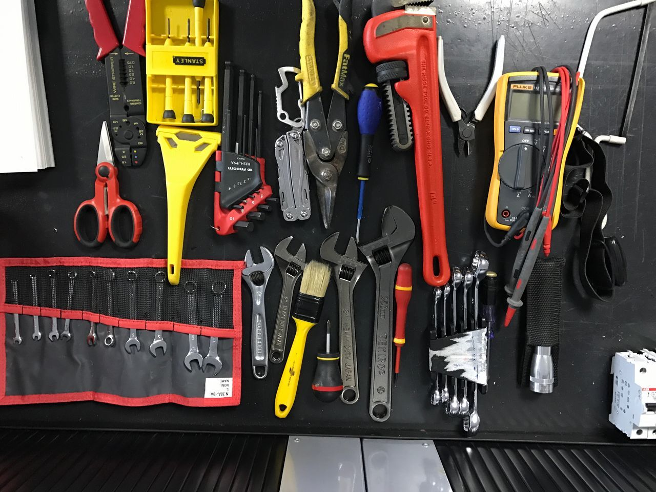 work tool, hand tool, wrench, large group of objects, indoors, no people, day