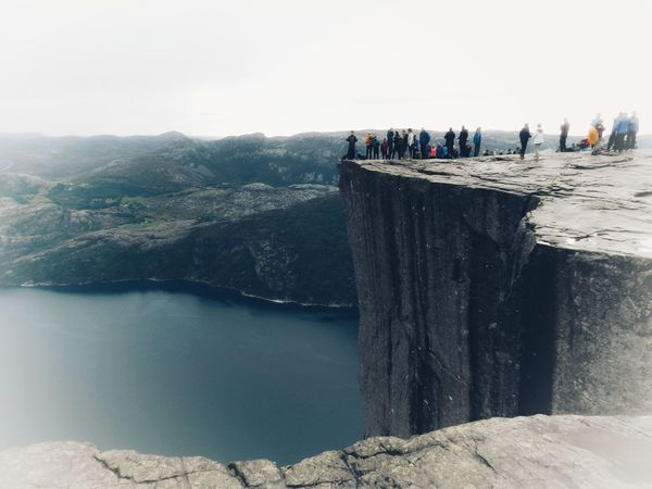 Norway Preikestolen Beauty In Nature Crowd Day Group Of People Holiday Large Group Of People Leisure Activity Mountain Mountain Range Nature Outdoors Real People Scenics - Nature Sky Tourism Tranquility Travel Travel Destinations Water Women