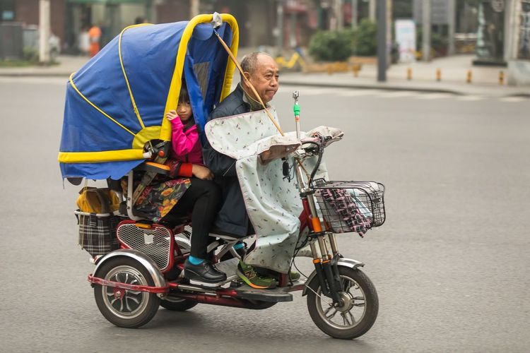 A well fitted and functional motorbike in the streets of Chengdu China Chengdu People Streetphotography Storytelling China Senior Adult Transportation Real People Mode Of Transportation Land Vehicle Full Length Adult Lifestyles