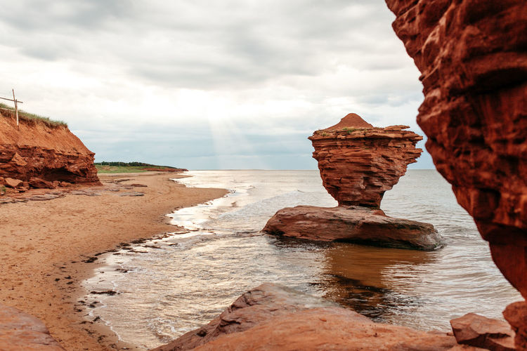 Sculptures of the Ocean Atlantic Atlantic Ocean Balance Beach Canada Cliff Coastline East Coast Geology Geometry Horizon Over Water Idyllic Physical Geography Prince Edward Island Red Sand Rock Rock - Object Rock Formation Sand Scenics Sea Shore The Great Outdoors - 2016 EyeEm Awards The KIOMI Collection Colour Of Life
