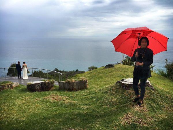 Big Sur Wedding Found On The Roll Wedding California Umbrella Rain Showers Vista Coastal Sky Cloudy Clouds Clouds And Sky Guest Bride And Groom Groom Bride Red Umbrella Woman Asian