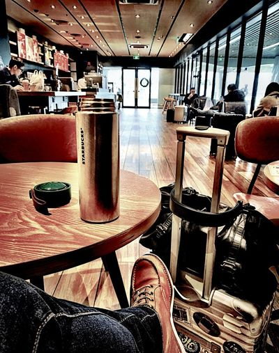 Starbucks Indoors  Human Body Part Low Section Real People One Person Human Leg Seat Day