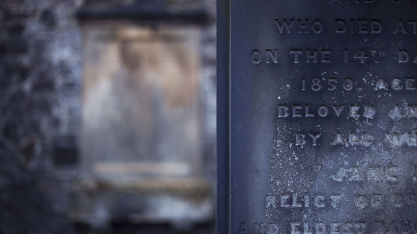 Gravestone Graveyard Scotland Cemetery Text Close-up No People Communication Glass - Material Western Script Indoors  Selective Focus Built Structure Architecture Focus On Foreground