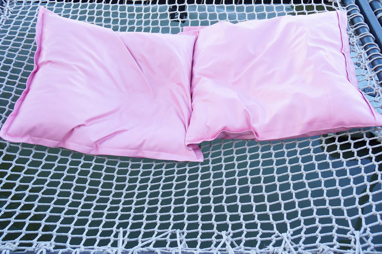 High angle view of pink fabric on table