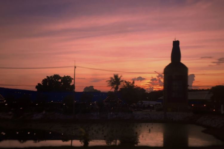 The Big Bottle in Thailand Sunset During The Way 🏎🏁 Architecture EyeEmNewHere Reflection Cloud - Sky Getting Inspired Clouds And Sky Light And Shadow Beauty In Nature The Week On EyeEm Silhouette Thank You My Friends 😊