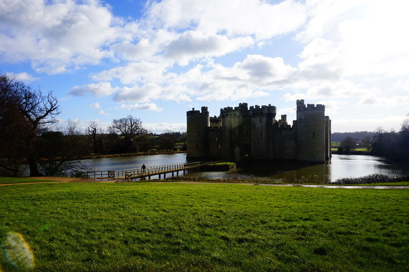 Bodiam Castle Architecture Blue Sky Blue Sky And Clouds Bodiam Castle Bridge Building Exterior Built Structure Castle Castle Grass Grassy Grassy Field History Landscape Light Medieval Medieval Architecture Outdoors Ruin Sky