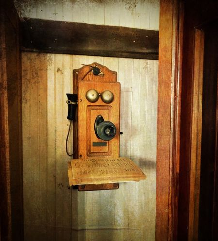 """""""Phone Home"""" A vintage public telephone booth in the museum of the tiny village of Corona, New Mexico puts modern technology in perspective. New Mexico Photography New Mexico Museum Historical Antique Vintage Phone Phone Booth Wood - Material No People Indoors  Old Antique Retro Styled History Communication"""